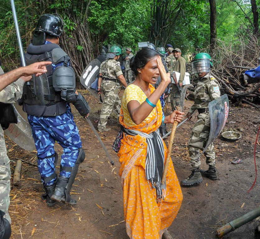 Khunti: Security personnel lathi-charge villagers during a search operation at the remote village of Ghagra, where Member of Parliament (MP) Karia Munda's three bodyguards, belonging to Jharkhand police, were allegedly kidnapped by Pathalgarhi supporters, in Khunti District on Wednesday, June 27, 2018. (PTI Photo) (PTI6_27_2018_000261B)