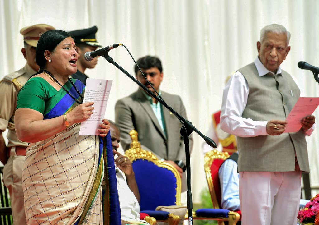 Bengaluru: Karnataka Governor Vajubhai Vala administers the oath to Kannada Veteran actress & Congress MLC Jayamala during the swearing-in ceremony of the new council of ministers of JD(S) and Congress coalition government, at Rajbhavan in Bengaluru on Wednesday, June 06, 2018. (PTI Photo/Shailendra Bhojak) (PTI6_6_2018_000116B)