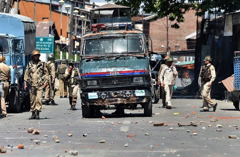 Srinagar: Police personnel during a clash with the protesters, in Srinagar on Saturday, Jun 02, 2018. Clashes erupted after police stopped the funeral procession of the youth Qaiser Amin Bhat who was killed after being hit and run over by a paramilitary vehicle yesterday. (PTI Photo/ S Irfan) (PTI6_2_2018_000100B)
