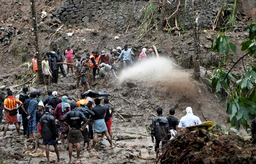 Kozhikode: Rescue workers and local people engaged in rescue works at landslide seen at Kattippara in Kozhikode on Thursday, June 14, 2018. (PTI Photo) (PTI6_14_2018_000236B)
