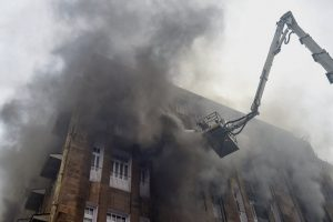 Mumbai: Firefighters try to douse a fire which broke out at Scindia house building, in South Mumbai on Friday, June 1, 2018. The blaze started on the third floor of the I-T office located in multi-storeyed Scindia House. (PTI Photo/Shashank Parade) (Story no BES8)(PTI6_1_2018_000166B)