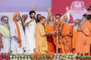 Ayodhya: Uttar Pradesh Chief Minister Yogi Adityanath lights the lamp during a function to celebrate the 80th birthday of Ram Janam Bhoomi Trust President Nritya Gopal Das, in Ayodhya on Monday, June 25, 2018. (PTI Photo) (PTI6_25_2018_000190B)