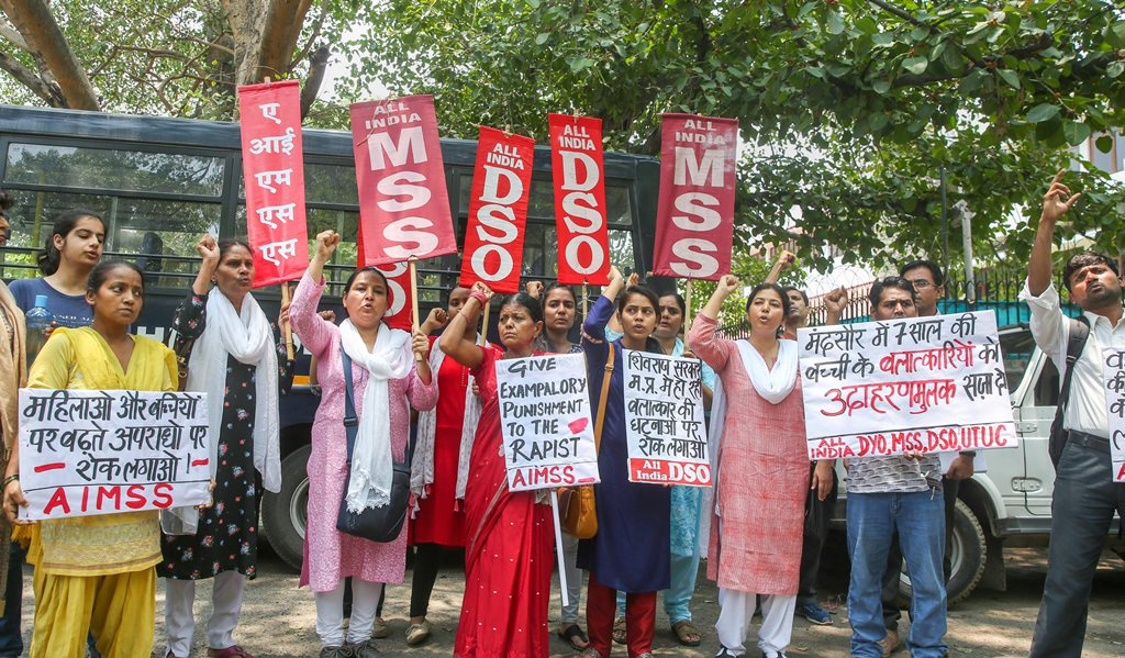 New Delhi: Members of AIMSS, AIDSO, AIDYO raise slogans during a protest demonstration over the rape of a 7-year old girl in Mandsaur (Madhya Pradesh), at Madhya Pradesh House in Chanakyapuri, New Delhi on Saturday, June 30, 2018. (PTI Photo)(PTI6_30_2018_000038B)