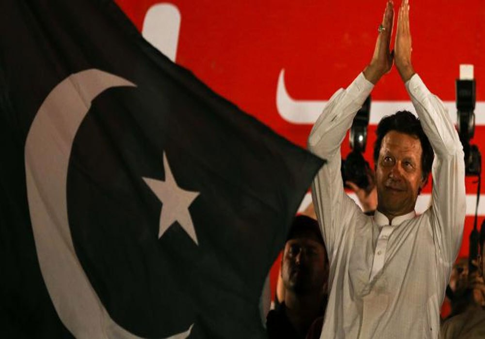 Imran Khan, chairman of the Pakistan Tehreek-e-Insaf (PTI) gestures to his supporters during a campaign meeting ahead of general elections in Islamabad, Pakistan, Jul 21, 2018. Reuters