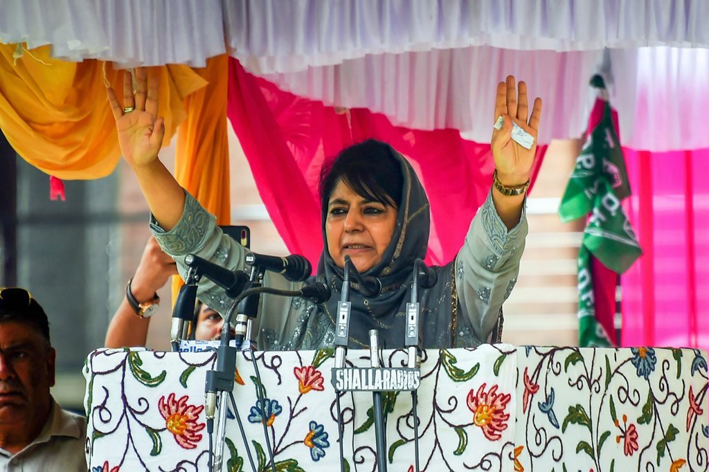 Srinagar: People's Democratic Party (PDP) President Mehbooba Mufti addresses her first public rally after stepping down as Jammu and Kashmir chief minister, at Sher-e-Kashmir Park, in Srinagar on Saturday, July 28, 2018. (PTI Photo/S Irfan) (PTI7_28_2018_000086B)