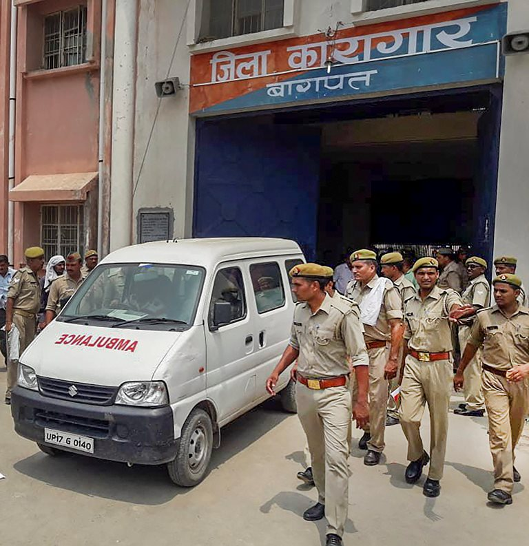 Baghpat: An ambulance carries the body of gangster Munna Bajrangi, who was shot dead in the Baghpat District Jail, allegedly by an inmate, in Baghpat on Monday, July 9, 2018. (PTI Photo) (PTI7_9_2018_000099B)
