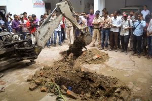 Muzaffarpur: Police investigate the site where a rape victim was allegedly buried, at a government shelter home in Muzaffarpur, on Monday, July 23, 2018. A girl of the home has alleged that one of her fellow inmates was beaten to death and buried at the premises of the facility, and several were raped. (PTI Photo)(PTI7_23_2018_000186B)