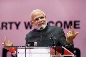 Kigali: Prime Minister Narendra Modi addresses the Indian community people during a reception at Kigali, in Rwanda on Monday, July 23, 2018. (PIB Photo via PTI) (PTI7_24_2018_000020B)