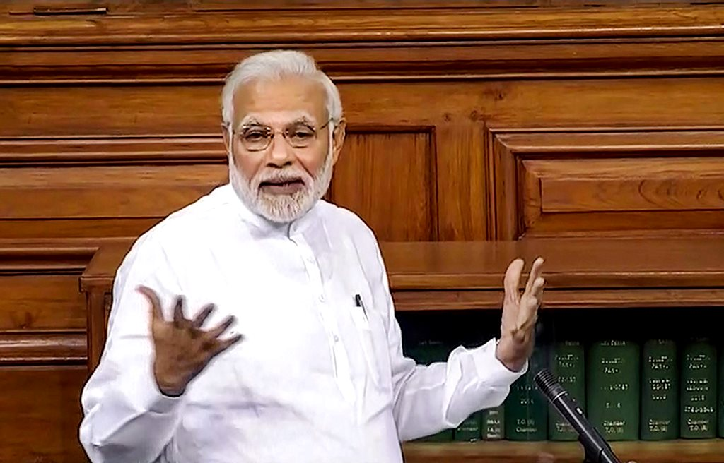 New Delhi: Prime Minister Narendra Modi speaks in the Lok Sabha on 'no-confidence motion' during the Monsoon Session of Parliament, in New Delhi on Friday, July 20, 2018. (LSTV GRAB via PTI)(PTI7_20_2018_000270B)