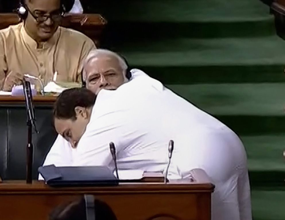New Delhi: Congress President Rahul Gandhi hugs Prime Minister Narendra Modi after his speech in the Lok Sabha on 'no-confidence motion' during the Monsoon Session of Parliament, in New Delhi on Friday, July 20, 2018. (LSTV GRAB via PTI)(PTI7_20_2018_000088B)