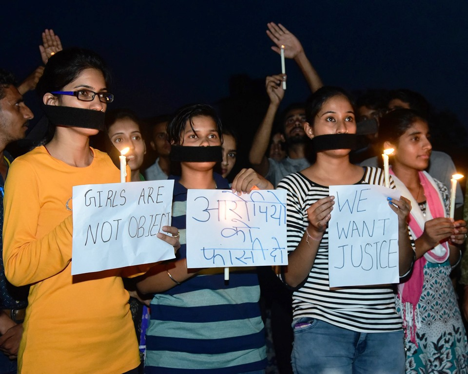 Bikaner:Youth take part in a candle march in protest against the rape of an eight-year-old girl in Mandsaur, at Bikaner on Saturday,June
