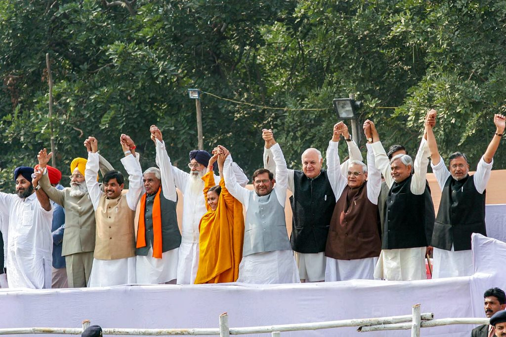 **FILE** New Delhi: In this Nov 24, 2005, file photo former prime minister Atal Bihari Vajpayee (3rd from R) is seen with other NDA leaders at a swearing-in ceremony in Patna. Vajpayee, 93, passed away on Thursday, Aug 16, 2018, at the All India Institute of Medical Sciences, New Delhi after a prolonged illness. (PTI Photo) (PTI8_16_2018_000191B)