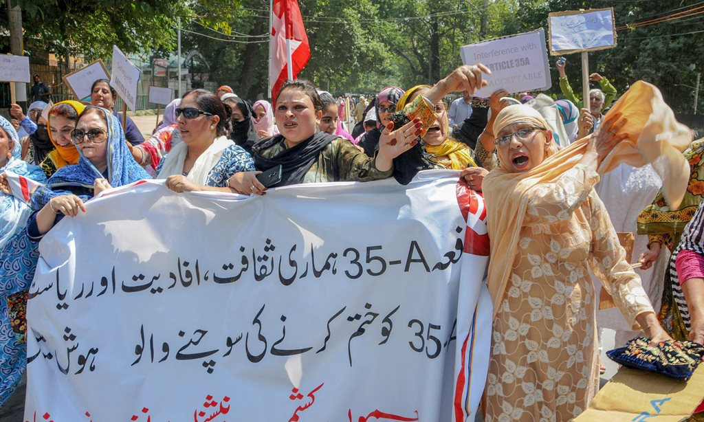 Srinagar: National Conference Women MLAs, MLCs, and other senior leaders raise slogans during a protest march against the petitions filed in the Supreme court challenging the validity of Article 35 A, in Srinagar on Saturday, Aug 4, 2018. Article 35 A, which was incorporated in the Constitution by a 1954 presidential order, accords special rights and privileges to the citizens of J&K. (PTI Photo) (PTI8_4_2018_000066B)