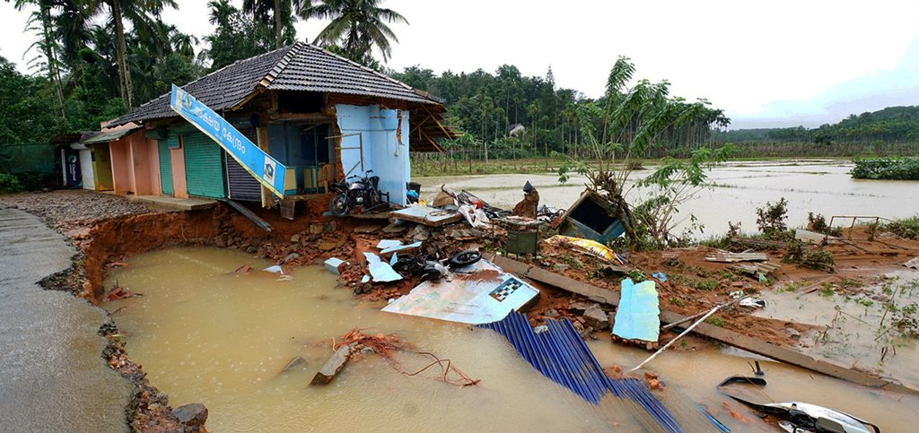 Wayanad: A road and building damaged after flood at Vithiri in Wayanad, in Kerala on Friday, Aug 10, 2018. (PTI Photo) (PTI8_10_2018_000231B)