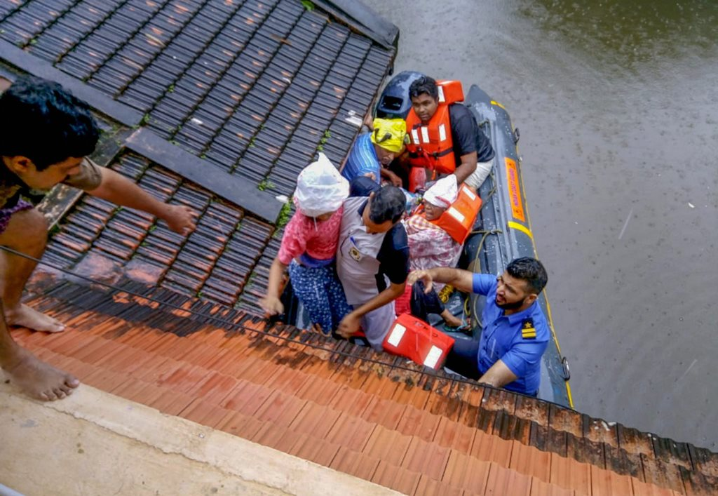 Kottayam : Rescue teams evacuate people from flood affected areas, to relief camps at Kottayam district in Kerala, on Monday, Aug. 20, 2018. (PTI Photo/Coast Guard)(PTI8_20_2018_000096B)