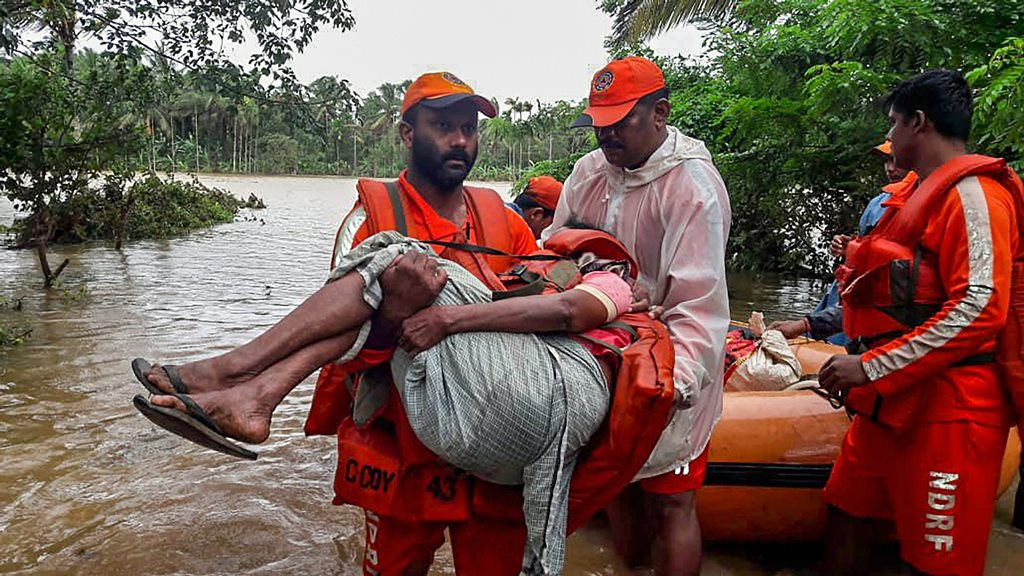 Wayanad: NDRF personnel rescue the flood-hit people in Wayanad, Kerala on Saturday, August 11, 2018. (@NDRFHQ Photo via PTI) (PTI8_11_2018_000205B)