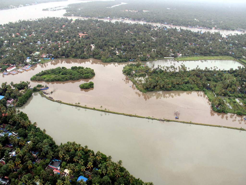 Kochi: An aerial view of Aluva town following a flash flood after heavy rains, in Kochi on Tuesday 14th Aug 2018. (Navy Photo via PTI) (PTI8_14_2018_000253B)