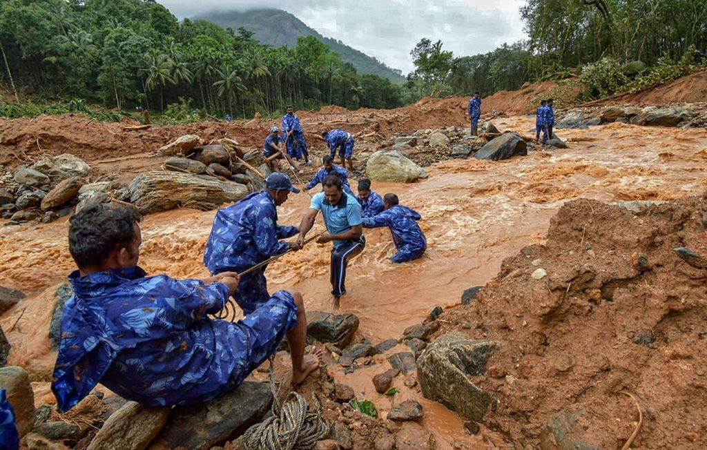 Palakkad: Rescue workers search for the bodies of missing persons after a landslide, triggered by heavy rains and floods, at Nenmara in Palakkad on Friday, Aug 17, 2018. 10 people have reportedly died in the mishap. (PTI Photo) (PTI8_17_2018_000199B)