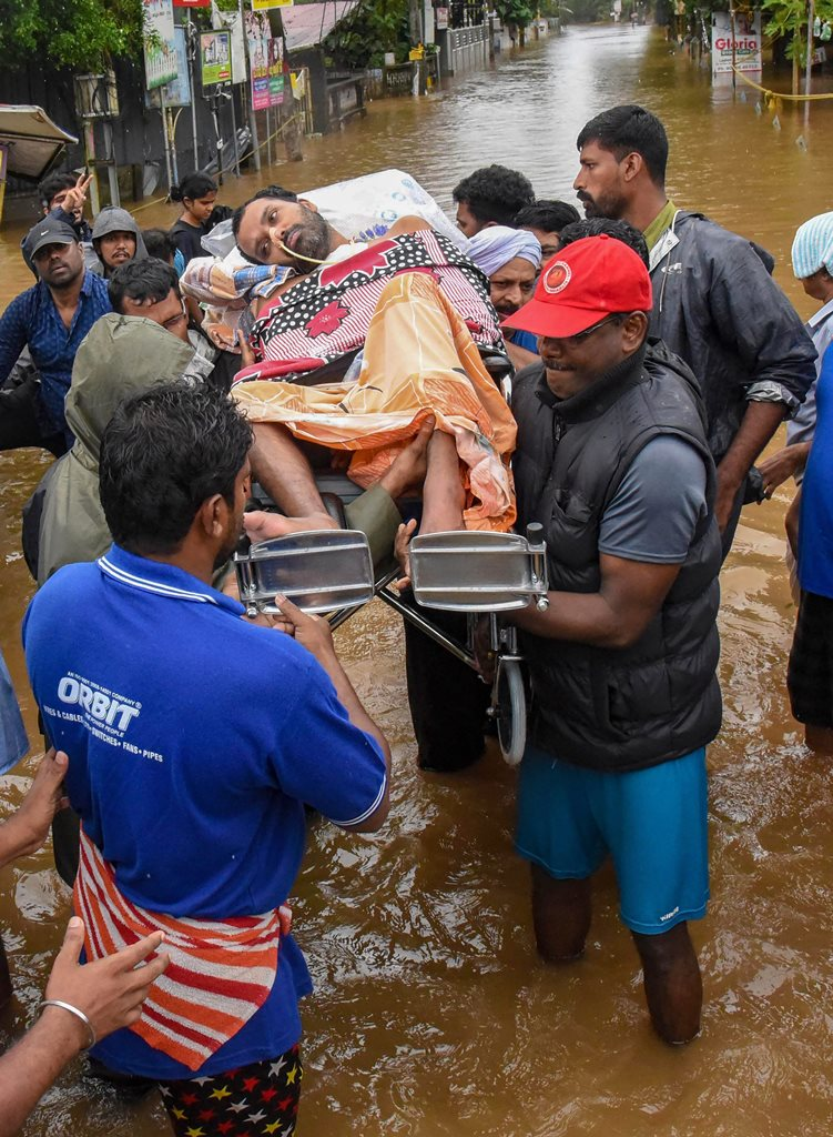 Kochi: A bed-ridden patient being rescued from a flood affected region following heavy monsoon rainfall, in Aluva at Kochi on Saturday, Aug 18, 2018. (PTI Photo) (PTI8_18_2018_000084B)