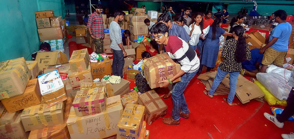 Kochi: Anbodu Kochi volunteers and District Civil officers organise relief material to be sent to flood affected areas, in Kochi on Tuesday, Aug 14, 2018. (PTI Photo) (PTI8_14_2018_000213B)
