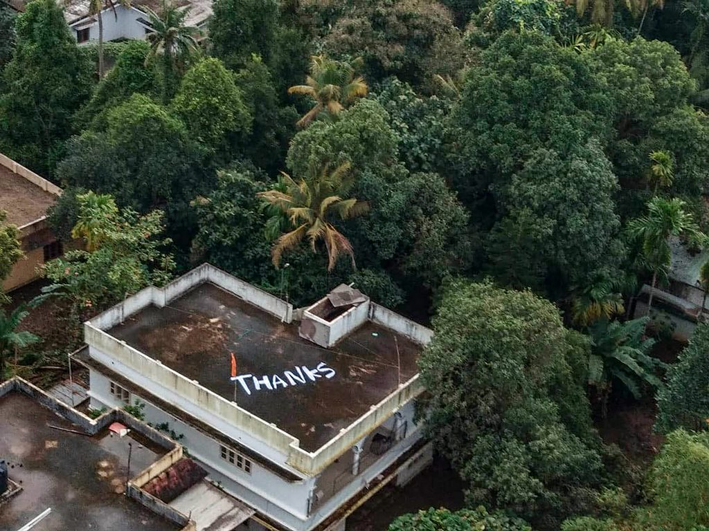 Kochi: 'Thanks' is written on the roof of a building to convey Kerala people's gratitude to Indian Navy and Air Force for their rescue and relief operations towards the flood-affected people, at North Paravoor in Kochi on Monday, Aug 20, 2018. (PTI Photo) (PTI8_20_2018_000263B)