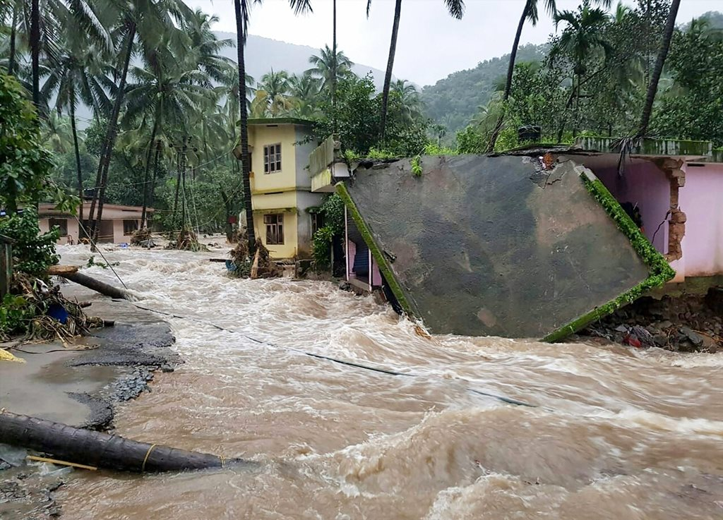 Kozhikode: Roof of a house collapses following a flash flood, triggered by heavy rains, at Kodencheri in Kozhikode district of Kerala on Thursday, Aug 9, 2018. (PTI Photo)(PTI8_9_2018_000230B)