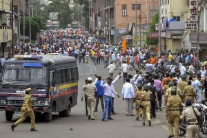Solapur: Police personnel clash with the Maratha Kranti Morcha protesters during their district bandh called for reservations in jobs and education, in Solapur, Maharashtra on Monday, July 30, 2018. (PTI Photo) (PTI7_30_2018_000215B)