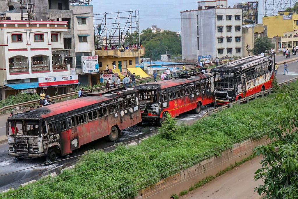 Pune: Maratha Kranti Morcha activists set ablaze buses during their district bandh called for reservations in jobs and education, near Pune, Maharashtra on Monday, July 30, 2018. (PTI Photo) (PTI7_30_2018_000246B)