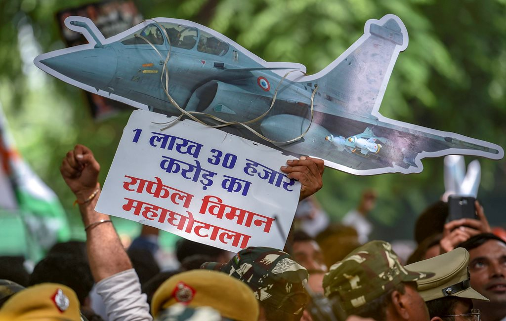New Delhi: Indian Youth Congress (IYC) members display a cut-out during a protest against Rafale deal scam, at Akbar Road in New Delhi on Thursday, Aug 30, 2018. (PTI Photo/Atul Yadav) (PTI8_30_2018_000121B)