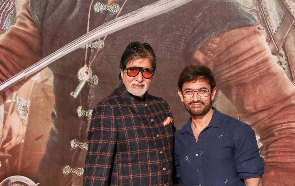 Mumbai: Bollywood actors Amitabh Bachchan and Aamir Khan pose for photos during the trailer launch of their upcoming film 'Thugs of Hindostan', in Mumbai, Thursday, Sept 27, 2018. (PTI Photo) (PTI9_27_2018_000062B)
