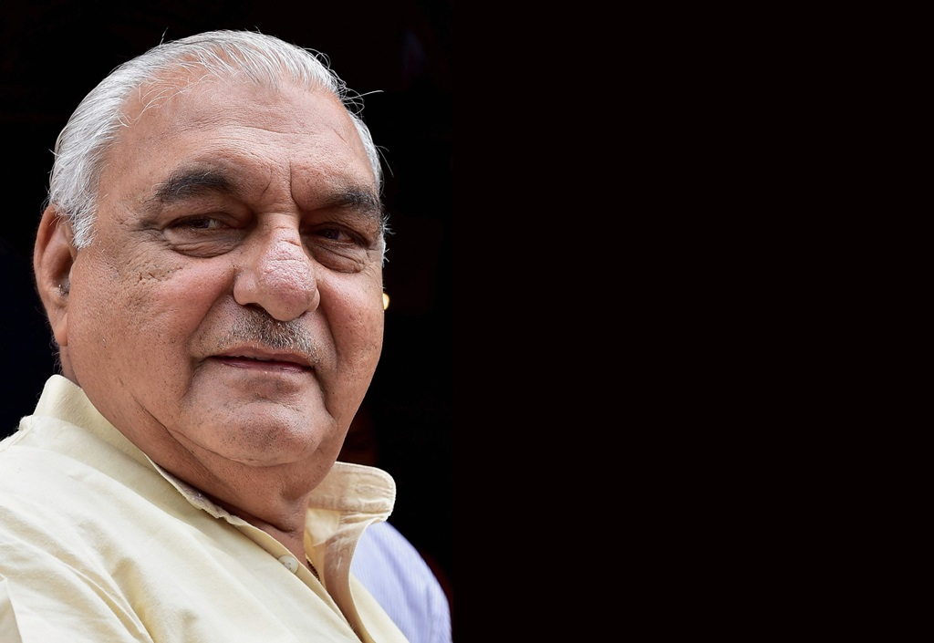New Delhi: In this file photo dated Aug 2, 2016, is seen former Haryana chief minister Bhupinder Singh Hooda, in New Delhi. Hooda and Congress leader Sonia Gandhi's son-in-law Robert Vadra were booked on Saturday by Haryana Police for alleged irregularities in land deals in Gurgaon. An FIR against Vadra, Hooda and two companies - DLF and Onkareshwar Properties - has been registered at Kherki Daula police station in Gurgaon, Manesar Deputy Commissioner of Police Rajesh Kumar told PTI. (PTI Photo/Kamal Kishore)