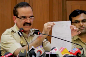 Maharashtra ADG Param Bir Singh with Pune's Additional CP Shivaji Bodke (L)Dr.Shivaji Pawar(R) adressed a press conference about the house arrest of rights activists in Bhima Koregaon case, at DGP office, in Mumbai on Friday.(PTI )