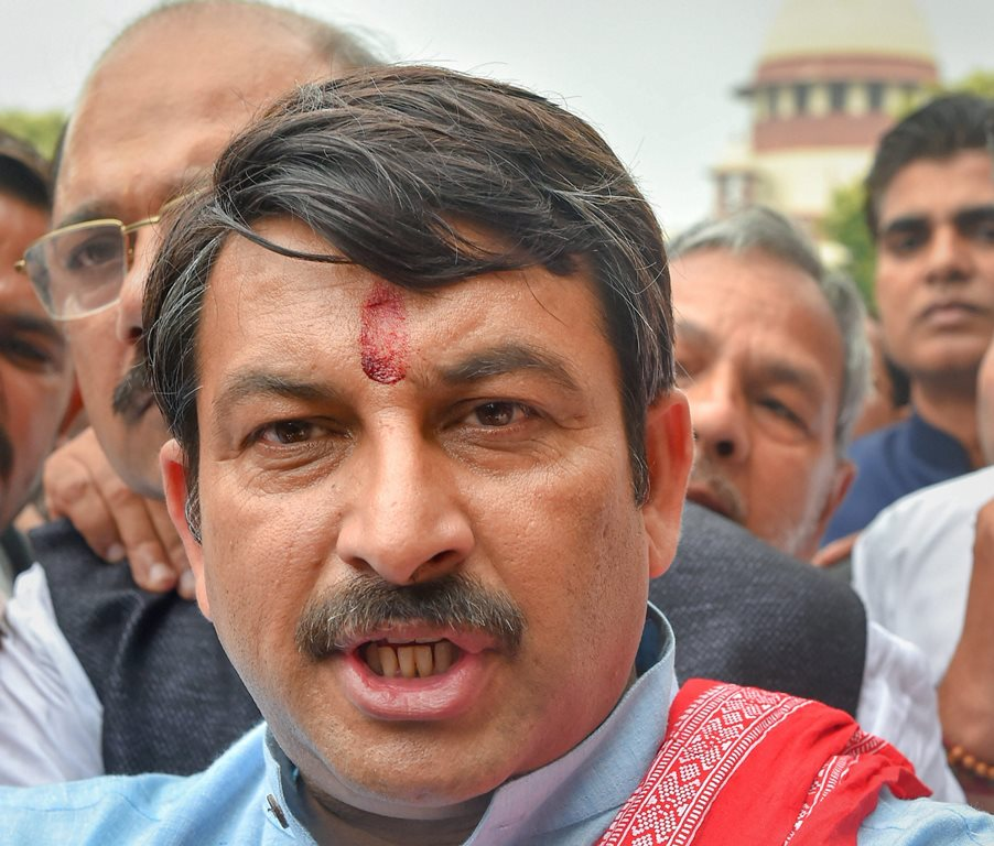 New Delhi: Delhi BJP President Manoj Tiwari addresses the media, outside the Supreme Court premises, in New Delhi, Tuesday, Sept 25, 2018. The Supreme Court took strong exception to Tiwari for allegedly violating its directions on the sealing of illegal structures in the national capital, and said that being an MP does not give him liberty to take the law in his hands. (PTI Photo/Kamal Kishore) (Story No. LGD28) (PTI9_25_2018_000056B)