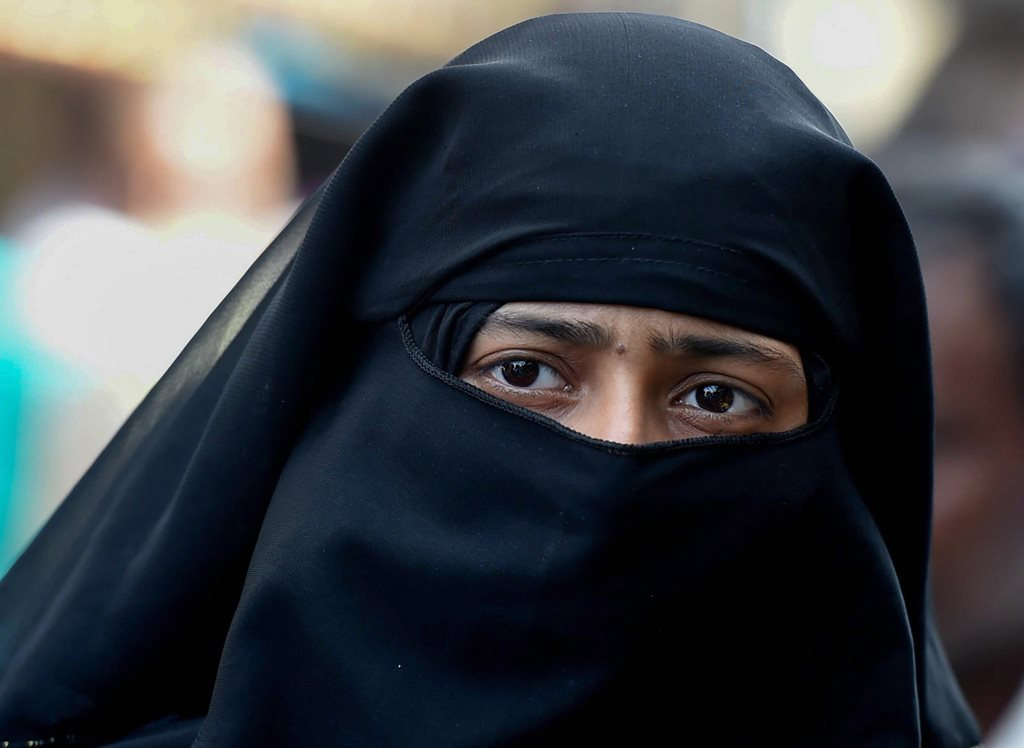 New Delhi: A Muslim woman looks on, near Jama Masjid in New Delhi, Wednesday, Sept 19, 2018. The Union Cabinet approved an ordinance to ban the practice of instant triple talaq. Under the proposed ordinance, giving instant triple talaq will be illegal and void and will attract a jail term of three years for the husband. (PTI Photo/Atul Yadav) (Story No. TAR20) (PTI9_19_2018_000136B)