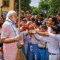 New Delhi: Prime Minister Narendra Modi greets schoolchildren as he undertakes a cleanliness drive under 'Swachhta Hi Sewa' campaign in the premises of Baba Sahib Ambedkar Higher Secondary School at Paharganj, in New Delhi, Saturday, Sept 15, 2018. (PTI Photo) (PTI9_15_2018_000052B)