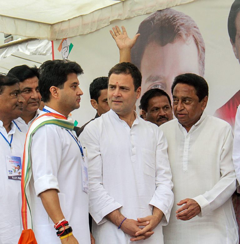 Bhopal: Congress President Rahul Gandhi (C), Congress leader and MP Jyotiraditya Madhavrao Scindia (L) and State President Kamal Nath during a roadshow, in Bhopal, Monday, Sept 17, 2018. (PTI Photo)(PTI9_17_2018_000088B)