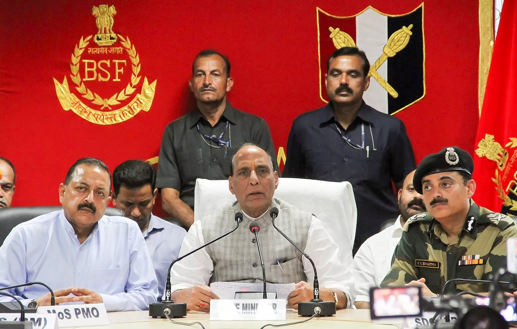Jammu: Home Minister Rajnath Singh (C) addresses the media as Mos for PMO Jitendra Singh (L) and DG BSF K K Sharma (R) look on, after the inauguration of first 'Smart Fence' pilot projects along International Border, in Jammu, Monday, Sept 17, 2018. (PTI Photo)(PTI9_17_2018_000094B)