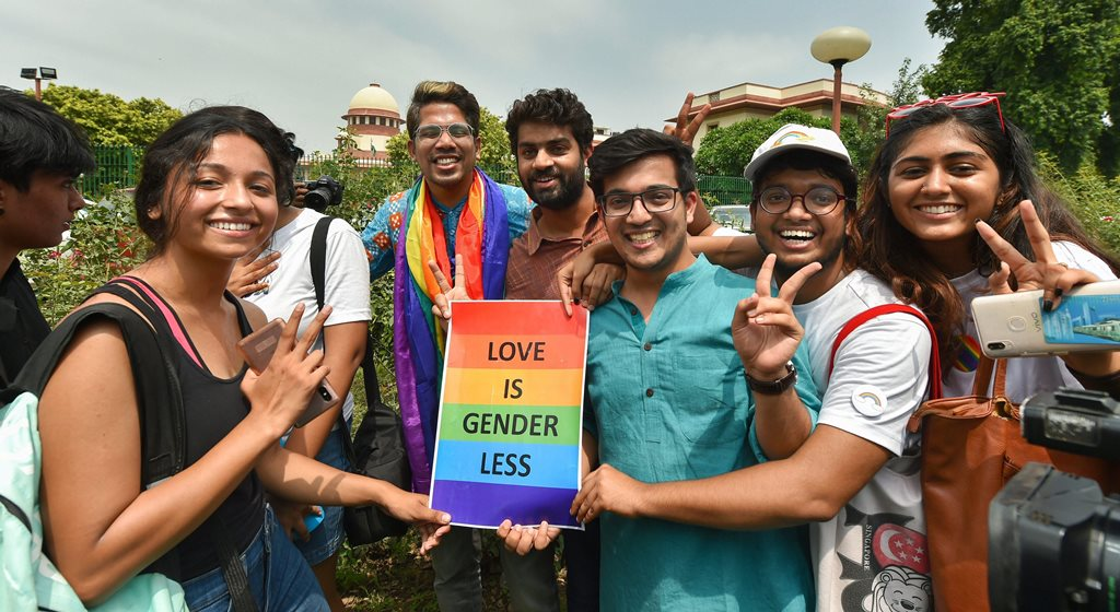 New Delhi: People react after the Supreme Court verdict which decriminalises consensual gay sex, outside the Supreme Court in New Delhi, Thursday, Sept 6, 2018. A five-judge constitution bench of the Supreme Court today, unanimously decriminalised part of the 158-year-old colonial law under Section 377 of the IPC which criminalises consensual unnatural sex, saying it violated the rights to equality. (PTI Photo/Kamal Kishore) (PTI9_6_2018_000101B)