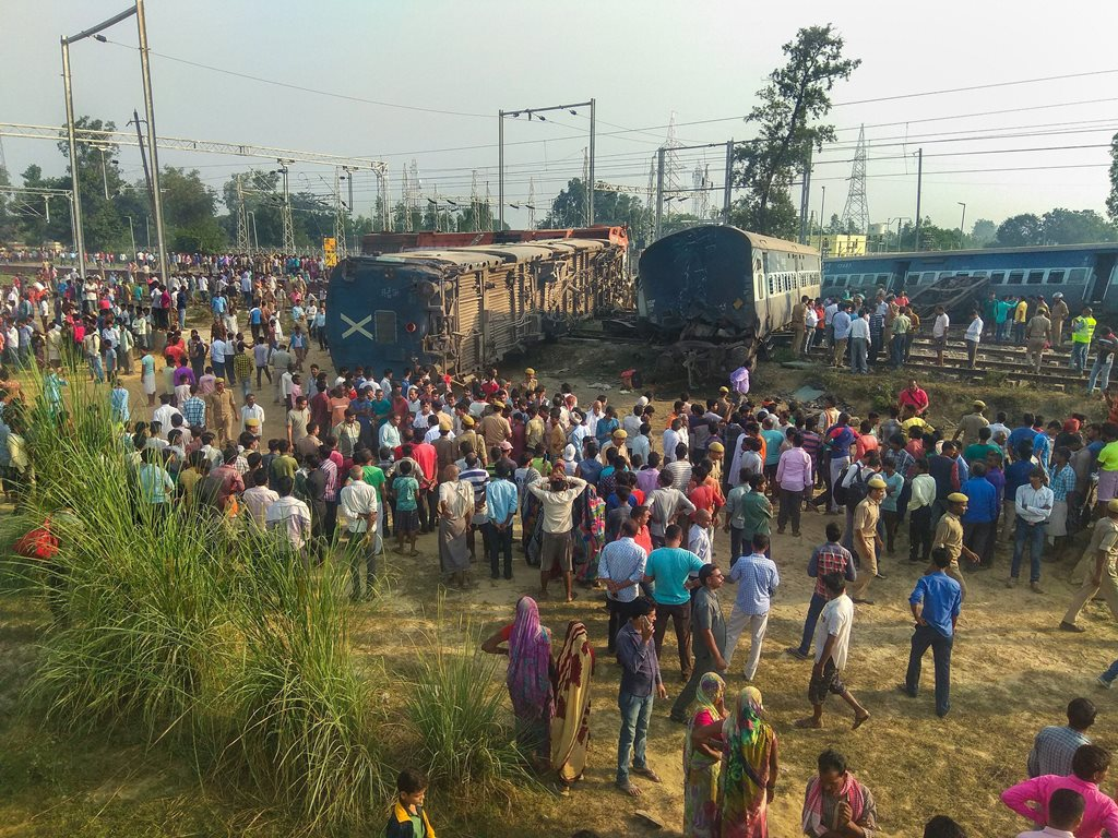 Raebareli: Police at locals at the site of the accident where eight coaches and the engine of the New Farakka Express train derailed near Raebareli, Wednesday, Oct 10, 2018. At least four people were killed in the accident. (PTI Photo) (PTI10_10_2018_000025B)