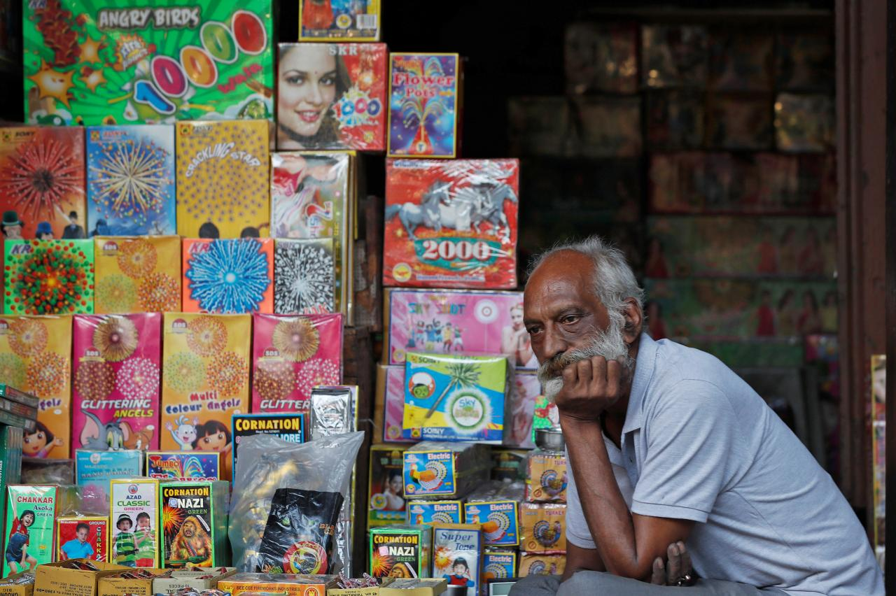 A shopkeeper waits for customers at his firecracker shop in the old quarters of Delhi, India, October 17, 2018. REUTERS/Adnan Abidi