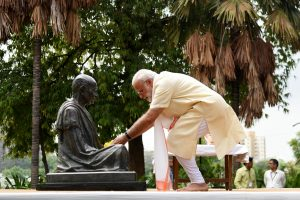 The Prime Minister, Shri Narendra Modi offers flower petals at Mahatma Gandhi bust, at the Sabarmati Ashram, in Ahmedabad, Gujarat on June 29, 2017.