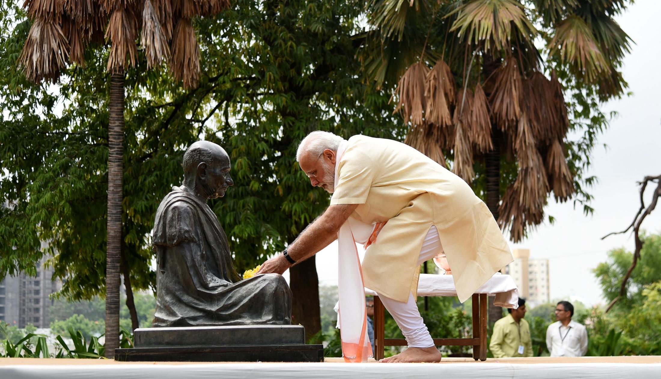 The Prime Minister, Shri Narendra Modi offers flower petals at Mahatma Gandhi bust, at the Sabarmati Ashram, in Ahmedabad, Gujarat on June 29, 2017.