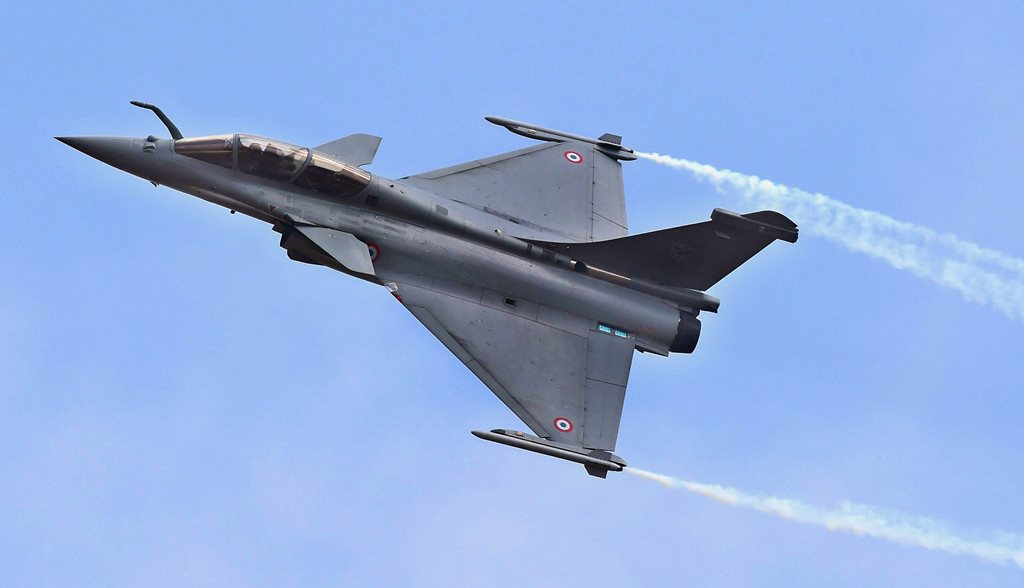 "New Delhi: In this Feb 14, 2017 file picture a Rafale fighter aircraft flies past at the 11th edition of Aero India 2017, in Bengaluru. Chief of the Air Staff, Air Chief Marshal BS Dhanoa defended the Rafale purchase as ""a game changer"" at the annual Air Force press conference in New Delhi, Wednesday. (PTI Photo) (PTI10_3_2018_000110B)"