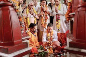 Datia: Congress President Rahul Gandhi offers prayers at Pitambara Peeth in Datia, Monday, Oct 15, 2018. MP Congress chief Kamal Nath and party leader Jyotiraditya Scindia are also seen. (PTI Photo) (PTI10_15_2018_000042B)