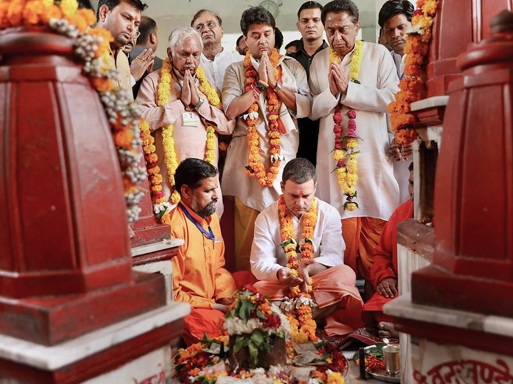 Datia: Congress President Rahul Gandhi offers prayers at Pitambara Peeth in Datia, Monday, Oct 15, 2018. MP Congress chief Kamal Nath and party leader Jyotiraditya Scindia are also seen. (PTI Photo) (PTI10_15_2018_000042B)
