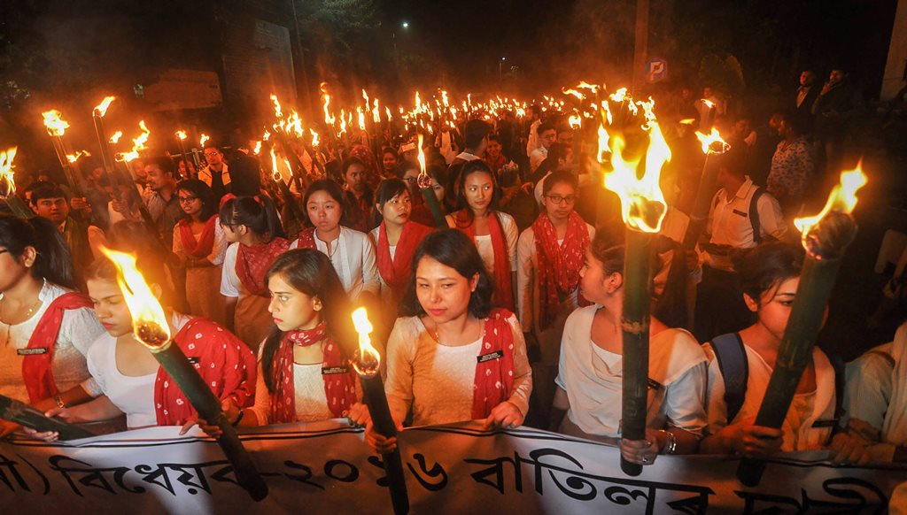 Guwahati: AASU activists with members of 28 ethnic organisations participate in a torch light procession against Citizenship (Amendment) Bill, in Guwahati, Friday, Nov. 16, 2018. (PTI Photo) (PTI11_16_2018_000079B)