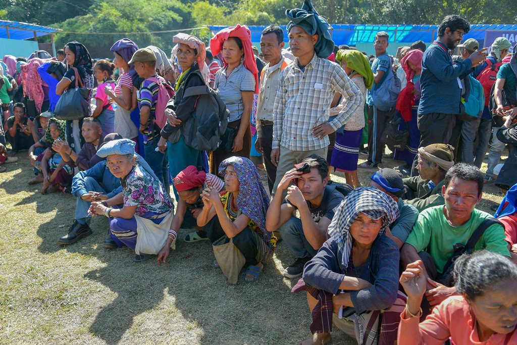 Kanhmun: Members of Bru tribe wait in a queue at a polling station during the state Assembly elections, at Kanhmun, Mizoram, Wednesday, Nov.28, 2018. (PTI Photo) (PTI11_28_2018_000126)