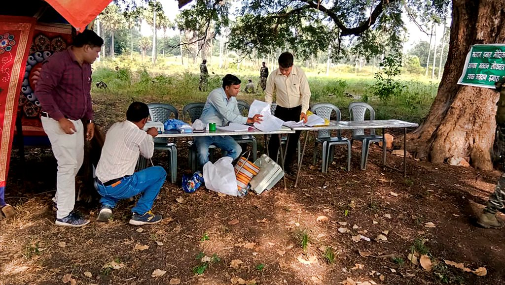 Sukma: A polling station set up undera tree during the first phase of Assembly elections in Chhattisgarh, in Sukma, Monday, Nov 12, 2018. (PTI Photo) (PTI11_12_2018_000011)
