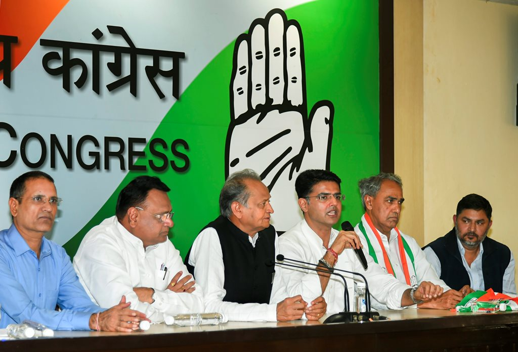 New Delhi: Rajasthan Congress chief Sachin Pilot speaks during a press conference after BJP MP from Dausa Harish Chandra Meena (2nd R) joined the Congress party, at AICC headquarter in New Delhi, Wednesday, Nov 14, 2018. Senior leader and former Rajasthan CM Ashok Gehlot is also seen. (PTI Photo/Subhav Shukla) (PTI11_14_2018_000094)