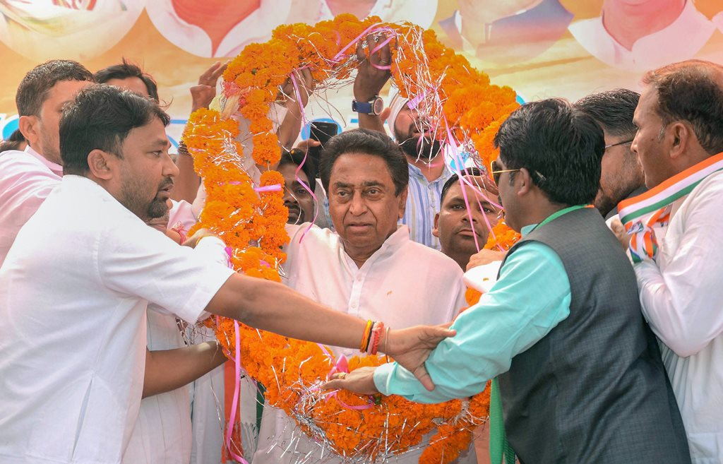 Jabalpur: Madhya Pradesh Congress president Kamal Nath being garlanded at an election rally ahead of the Assembly elections, in Jabalpur, Saturday, Nov. 17, 2018. (PTI Photo) (PTI11_17_2018_000075B)